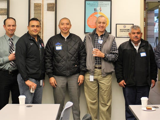 A group photo marks binational cooperation of LCU staff