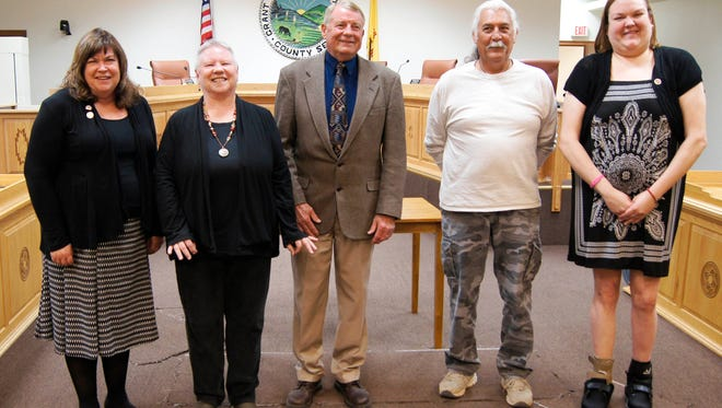 Mayor Ken Ladner, center, was sworn into office on Monday, as well as re-elected councilors Lynda Aiman-Smith, second from left, and Guadalupe Cano, at right. Also attending were Councilor Cynthia Ann Bettison, left, and Councilor Jose Ray, second from right. The Town Council will hold it's first meeting under the direction of Mayor Ladner at 6 p.m. tonight at the Grant County Administration Building.