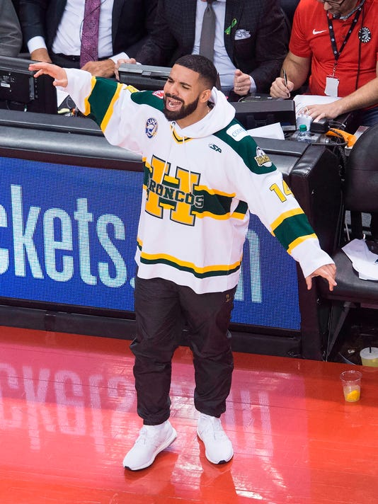 Rapper Drake wears a Humboldt Broncos jersey during the second half of Game 1 of an NBA basketball first-round playoff series between the Washington Wizards and the Toronto Raptors in Toronto on Saturday, April 14, 2018. (Nathan Denette/The Canadian Press via AP)