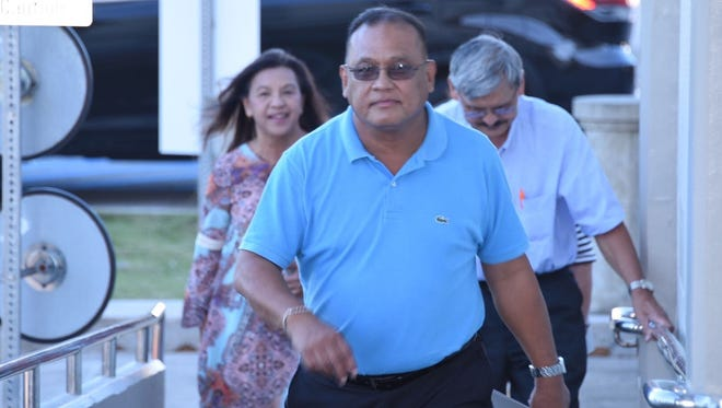 Kenneth Chargualaf of the Guam Education Board, center, arrives at District Court of Guam for a hearing following a lawsuit filed against the board by Jon Fernandez, superintendent of education, on Nov. 18, 2016.