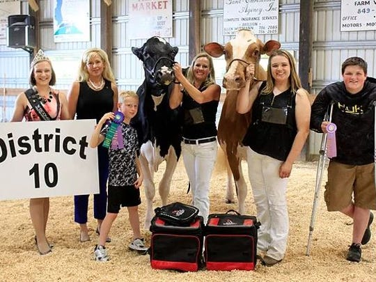District 10 Grand Champion and Reserve Grand Champion of the Open Show (from left) WHA Princess Courtney Moser, Judge Mandi Bue, Cameron Ryan, Grand Champion Ryan-Vu Chelios Mocha exhibited by Ryan Vu, Amy Ryan, Reserve Grand Champion Jimdandy Bw Glimmer-Red, McKenna Coffeen, Coltin Coffeen.