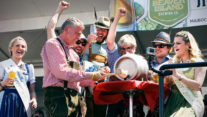 St. Cloud Mayor Dave Kleis tapped the ceremonial keg of Maibock beer during the Mia Bock festival Saturday, May 21, 2016, at Beaver Island Brewing Co. in St. Cloud.