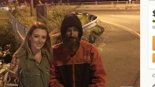 Kate McClure poses with Johnny, the homeless Veteran who spent his last $20 to help her.