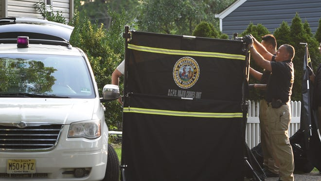 Members of B.C.P.D. Major Crimes Unit, provide cover in preparation for the body to be brought out at the home of Janoris Jenkins where a body was discovered there this morning. Photographed at the corner of Van Saun Place and Newton Place in Fair Lawn on 06/26/18.