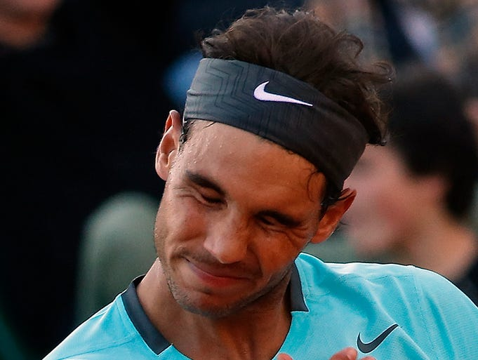 Spain's Rafael Nadal reacts as he plays compatriot David Ferrer.