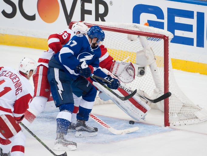 Tampa Bay Lightning center Alex Killorn slips the puck