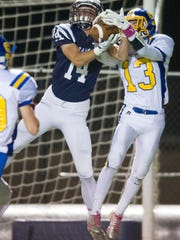 Sweetwater's Jordan Whitfield (13) unsuccessfully attempts to catch a pass meant for Grace Christian's Ben Andrews (14) during a game at Grace Christian on Friday, Oct. 14, 2016.