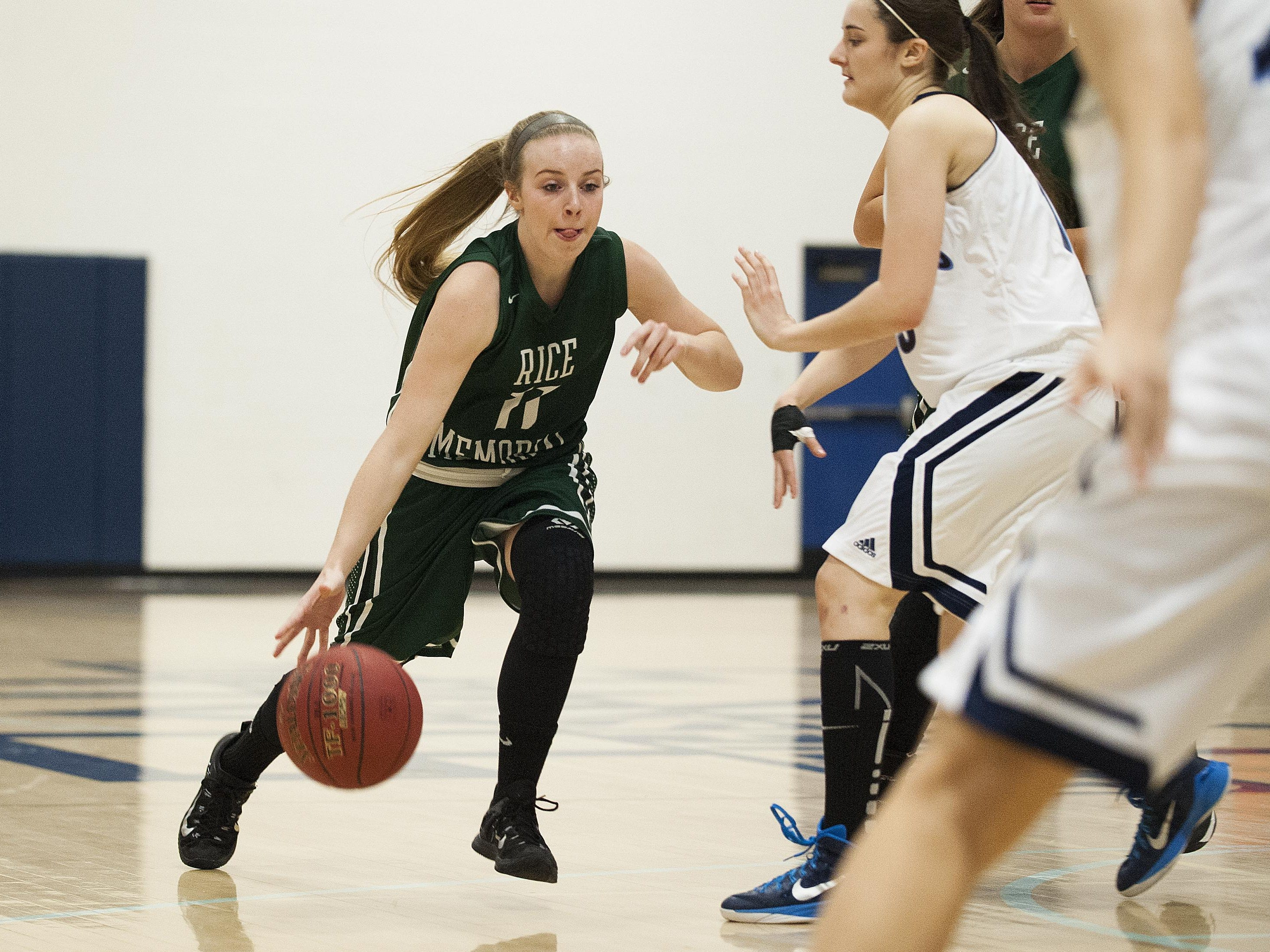 Rice guard Jordan Lawrence (11) drives to the hoop during the girls basketball game between the Rice Green knights and the Mount Mansfield Cougars at MMU High School on Friday night December 4, 2015 in Jericho.