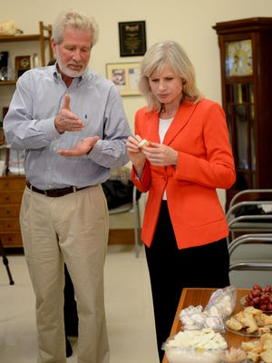 Mark Schleitwiler, vice president of finance for BelGioioso Cheese, Inc. in Ledgeview, offers samples to Democratic gubernatorial candidate Mary Burke during her tour of the facility on Tuesday.