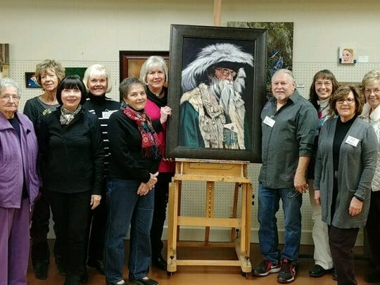 "Mike Lanier gave an oil glaze demonstration on ""How to Change a Good Painting to Make It Better"" at the January meeting of the Abilene Creative Arts Club. Back row, from left: Angela Lewis, Brenda Lauw, Jean Hensley, Marianne Fincher, Barbara Edwards, Mike Lanier, Doris Kinney, Bill Shelton and Bill Shields. Front row: Fran Winkles, Queba James, Liz Bogard, Margaret Davis, Mary Brooks, Dorothy Whisenhunt, Lisa Ward and Marianne Wood. Not pictured: Teresa Johnston and Shirley Minzenmeyer."