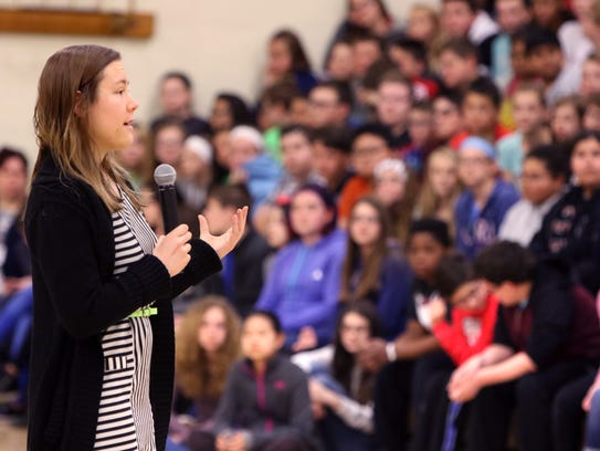 Erin Magennis, a Carthage College student, talks with