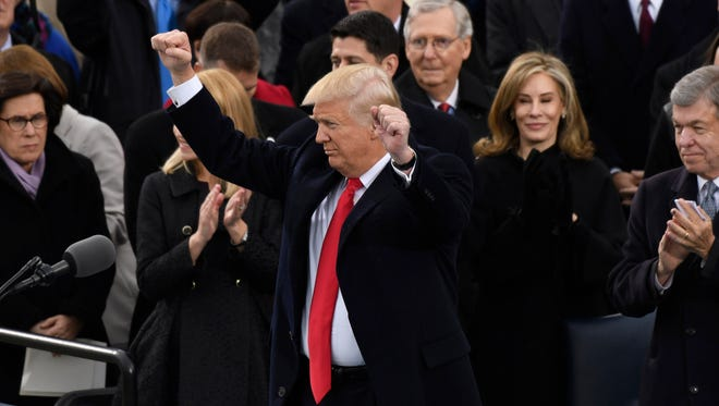 President Donald Trump acknowledges the crowd after speaking during his 2017 Presidential Inauguration.