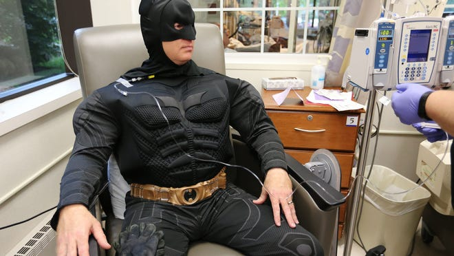 Springfield Police Officer James Dougherty receives a chemotherapy treatment at Mercy's O'Reilly Cancer Center on Thursday, May 28, 2015. Dougherty has been wearing different super hero costumes during treatment because his son believes that super heroes can beat anything.
