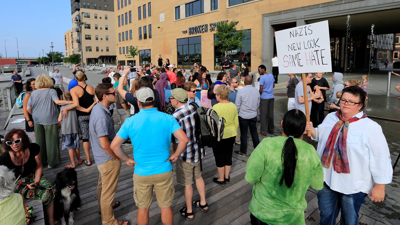 About 75 people gathered on CityDeck Tuesday evening to respond to violence in Charlottesville, Va., with a message of peace, love, and inclusion.