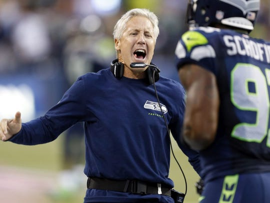 Seattle Seahawks head coach Pete Carroll reacts to