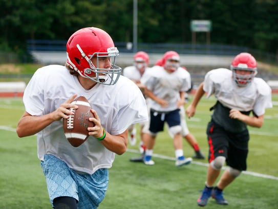 Chenango Forks' Troy Arno looks to pass during practice