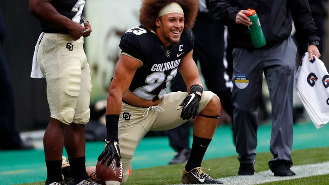 """FILE - In this Oct. 28, 2017, file photo, Colorado running back Phillip Lindsay (23) watches from the sideline during the first half of an NCAA college football game against California in Boulder, Colo. Lindsay arrived in Boulder coming off a severe and concerning knee injury. He also brought this: An infectious energy and robust work ethic. That knee injury never held him back and now the Colorado senior nicknamed """"Tasmanian Devil"""" is on the verge of rewriting the school's rushing record. (AP Photo/David Zalubowski, File)"""