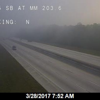 Traffic cameras capture lingering smoke just off of