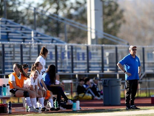 U-Prep's varsity girls soccer coach, Rich Bourne, watches