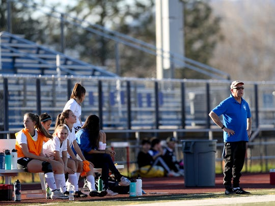U-Prep's varsity girls soccer coach, Rich Bourne, watches the team during a 2018 home match against Yreka.