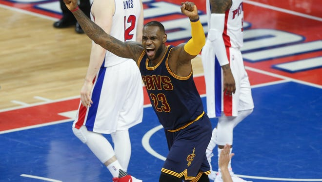 Pistons center Aron Baynes and guard Kentavious Caldwell-Pope walk away as Cavaliers forward LeBron James celebrates a three-pointer by Kyrie Irving during the final seconds of the fourth period Friday at the Palace.