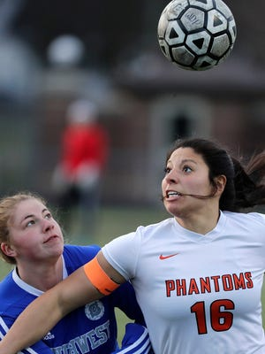 West De Pere's Angie Cortes (16) wins a header against Green Bay Southwest's Emma Pierce in an April 27 game at West De Pere.
