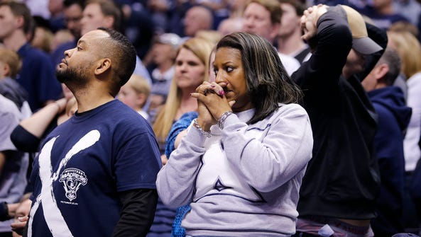 Xavier fans can barely watch as the game is tied during