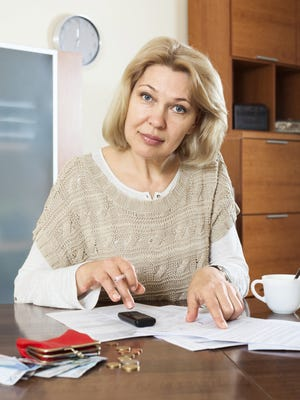 Serious  woman  with documents money