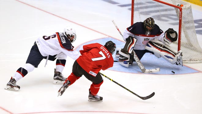 Canada's Aidan Dudas, right, has a shot on USA goalie Drew DeRidder during the final between Canada and USA at the Kristins Hall during the Winter Youth Olympic Games in Lillehammer, Norway, on Sunday Feb. 21, 2016. USA went on to win the game.