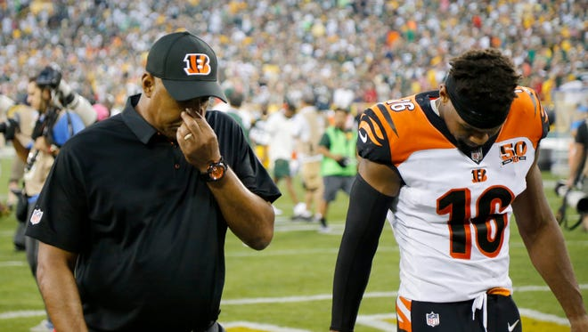 Cincinnati Bengals head coach Marvin Lewis walks to the locker room after overtime of the NFL Week 3 game between the Green Bay Packers and the Cincinnati Bengals at Lambeau Field in Green Bay on Sunday, Sept. 24, 2017. The Bengals were dropped to 0-3 after a 27-24 overtime loss in Green Bay.