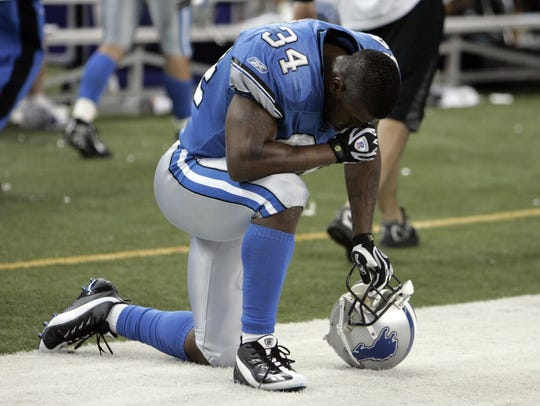 2007: Lions running back Kevin Jones kneels with his