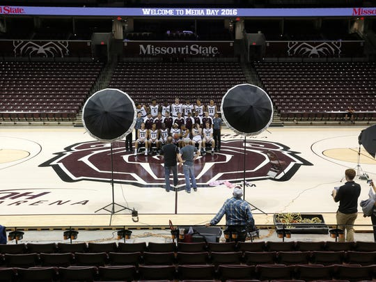 The men's basketball team gets set up for a team portrait during Media Day at JQH Arena on Wednesday.