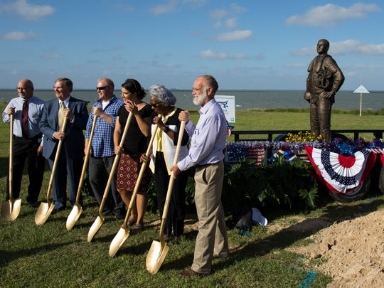 City officials pose for a photo during the Naval Aviator Memorial ground breaking at Ropes Park on Thursday, June 15, 2017.