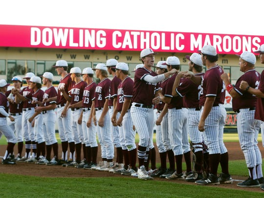 Dowling players line up on the field Saturday, July 29, 2017, in the 4A state baseball championship game at Principal Park in Des Moines.