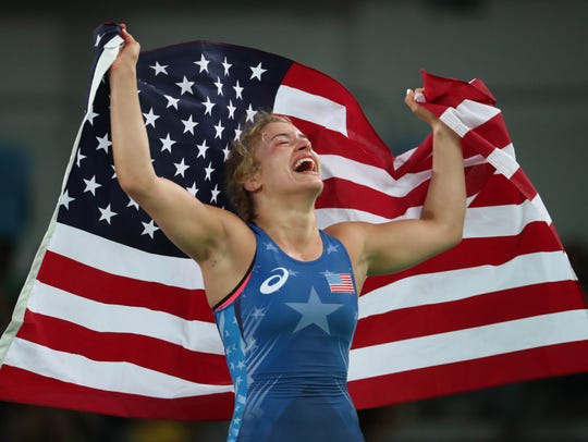 Helen Maroulis celebrates after winning a gold medal