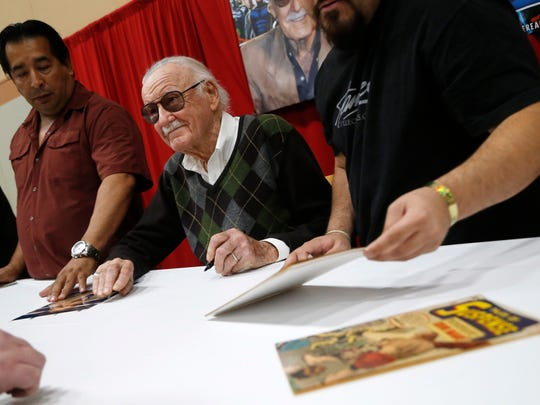Comic book legend Stan Lee signs autographs for fans Friday, May 19, 2017, at Wizard World Des Moines.
