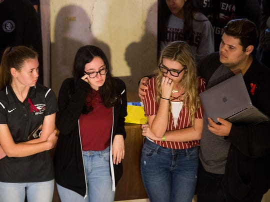 Sarah Chadwick, from left, Sofie Whitney, Delaney Tarr, and Demitri Hoth, all students at Marjory Stoneman Douglas High School, wait for their turn to speak during a press conference at The Capitol Complex to advocate for stricter gun control and better mental health care Wednesday, Feb. 21, 2018 in Tallahassee, Fla.