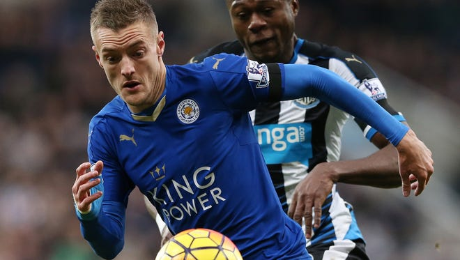 Striker Jamie Vardy and Leicester City have used a strong offense and tough defense to surge to the top of the Premier League.
