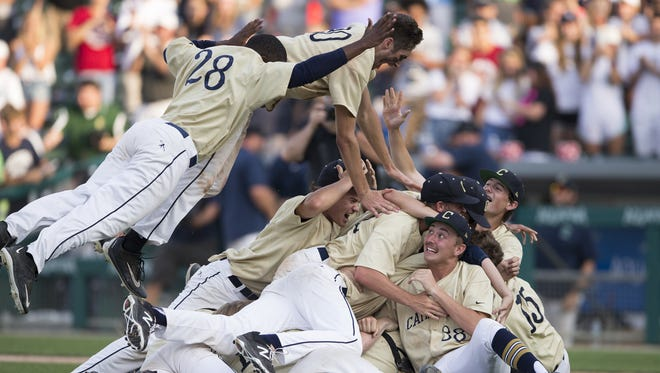 Cathedral players celebrated their victory over Penn State in the 4A baseball state title game June 17 at Victory Field. Cathredral won 4-3 in eight innings, and ended the season a perfect 29-0.