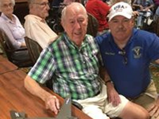 Sean Tracy with one of the resident veterans at a senior