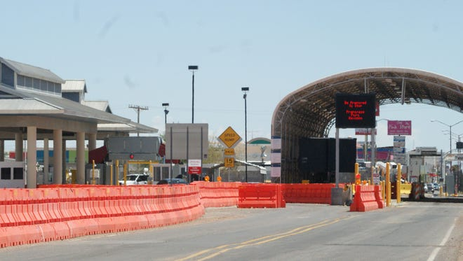 Construction on a new port of entry near Columbus continues despite no funding approval for flood protection.