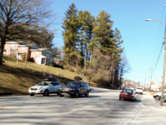 Traffic moves up and down Merrimon Avenue at its intersection