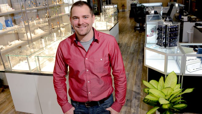 David Sweet is pictured inside his shop Revival Collectibles Tuesday, Nov. 29, 2016 in Grand Ledge. Sweet turned a passion of collecting into a brick-and-mortar operation. His shop buys and sells jewelry, Swarovski items, antiques and more.