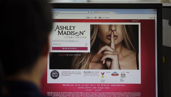 A June 10, 2015 photo from files showing Ashley Madison's Korean web site on a computer screen. in Seoul, South Korea.