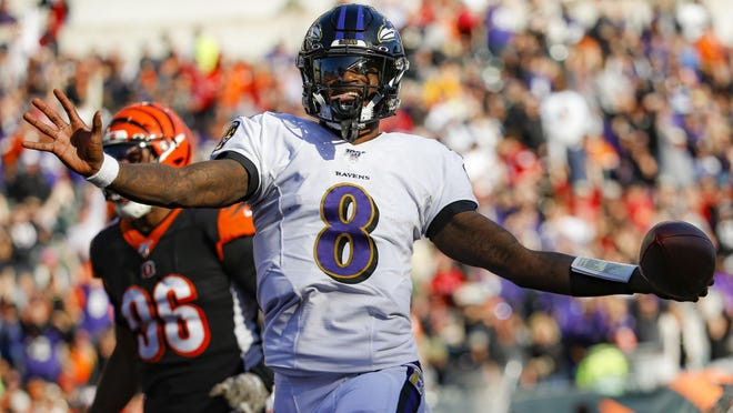 Baltimore Ravens quarterback Lamar Jackson runs for a touchdown during the sdcond half of a Nov. 10 game against the Cincinnati Bengals in Cincinnati.