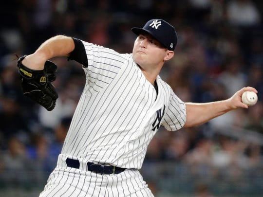 New York Yankees' Zach Britton delivers a pitch during the eighth inning of the team's baseball game against the Kansas City Royals on Thursday, July 26, 2018, in New York.
