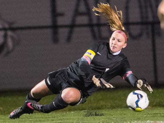 Elco goalkeeper Emma Strickler just misses the ball