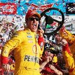 Joey Logano celebrates in victory lane after winning the 57th Annual Daytona 500 on Sunday at Daytona International Speedway. It was his first Daytona 500 victory.