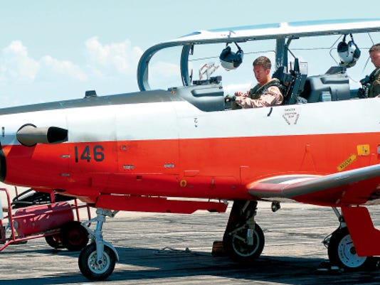 "During the U.S. Navy training flights at the Las Cruces International Airport a student pilot sits in the front of a T-6 ""Texan II"" while an instructor flies in the rear."