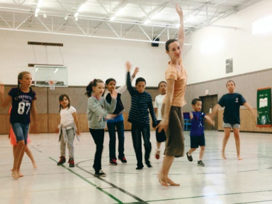 Submitted Photo   In front, camp instructor Sarah Williams leads a dance number during rehearsals for the First United Methodist Church Performing Arts Camp.